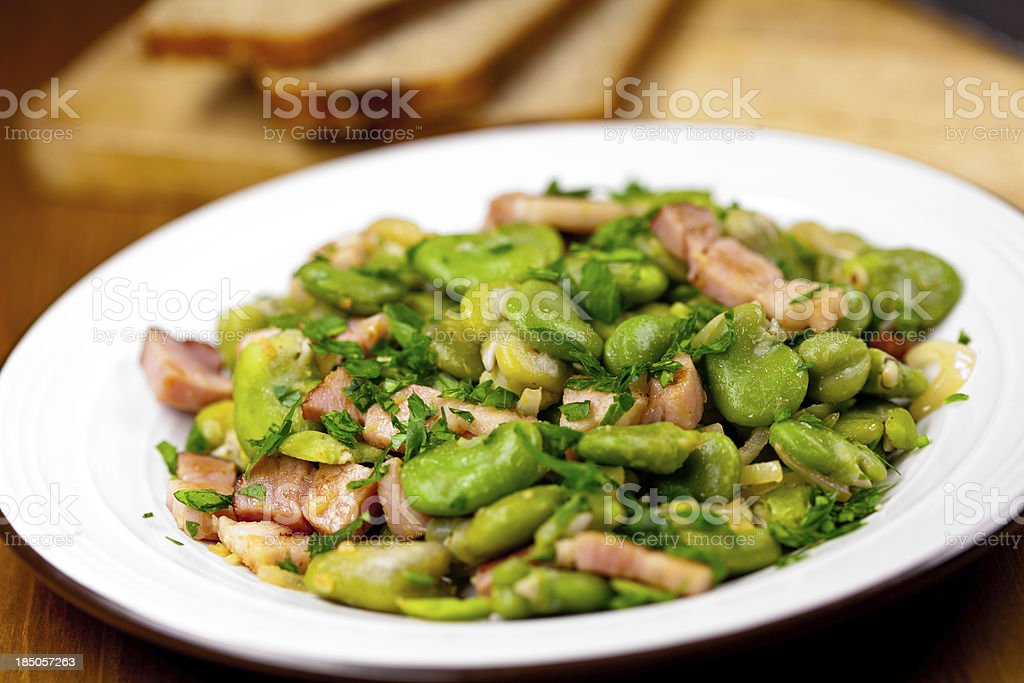 Broad bean with bacon stock photo