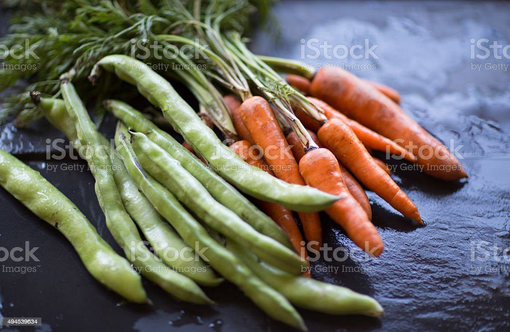 Broad Beans and Carrots stock photo