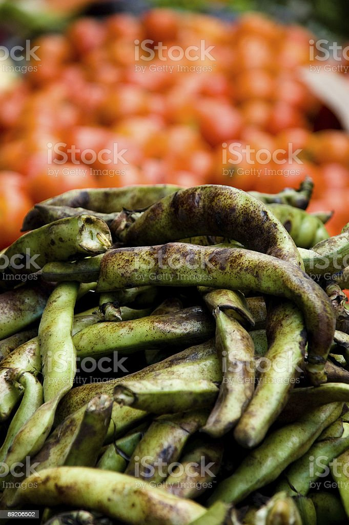 Broad beans and tomatoes in Moroccan street market royalty-free stock photo