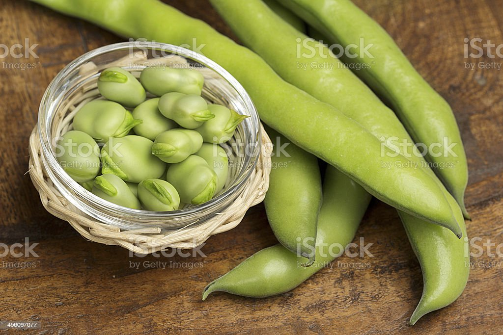broad beans in a glass bowl stock photo