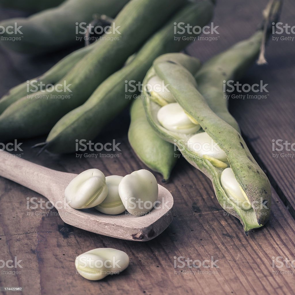 Broad Beans on a wooden Table with Spoon stock photo