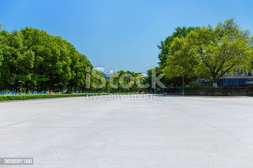 istock Broad square and dense woods in the sun, outdoor park 969591166