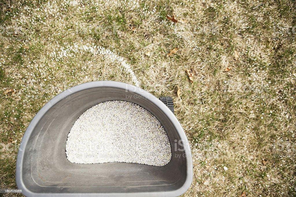 Broadcast Spreader Applying Fertilizer to Grass royalty-free stock photo
