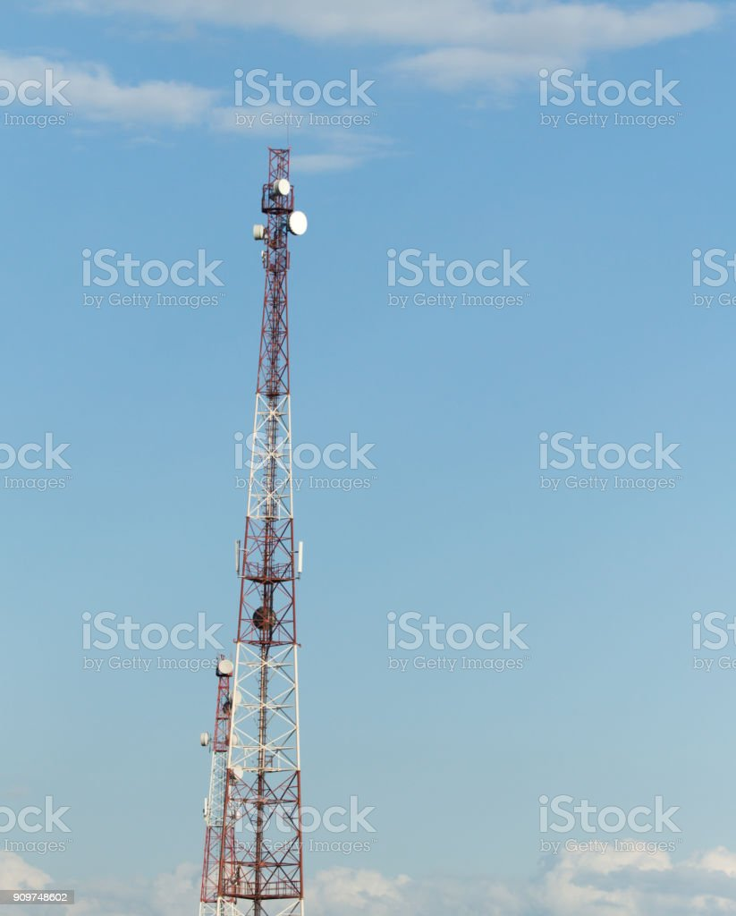 TV broadcasting antenna against the sky stock photo