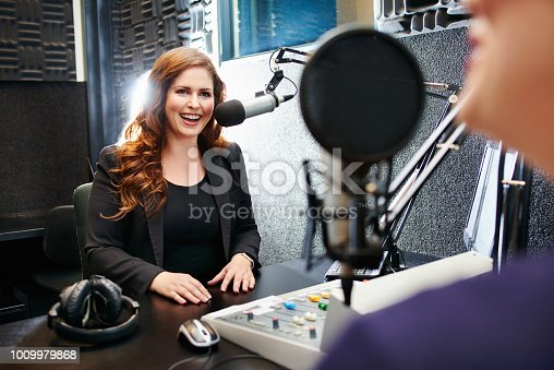 Shot of a young woman working in a recording studio