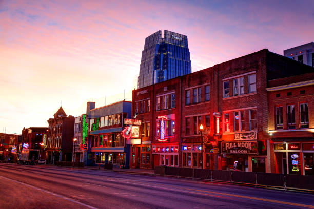 Broadway in downtown Nashville, Tennessee Broadway in downtown Nashville, Tennessee. Lower Broadway is a renowned entertainment district for country music. Nashville is the capital of the U.S. state of Tennessee. Nashville is known as the country-music capital of the world. The city is also known for its culture and commerce and great bar scene. tennessee stock pictures, royalty-free photos & images