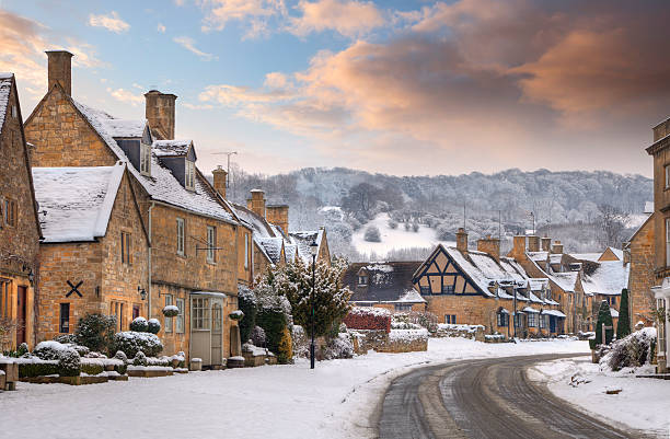 broadway in snow - village stock pictures, royalty-free photos & images