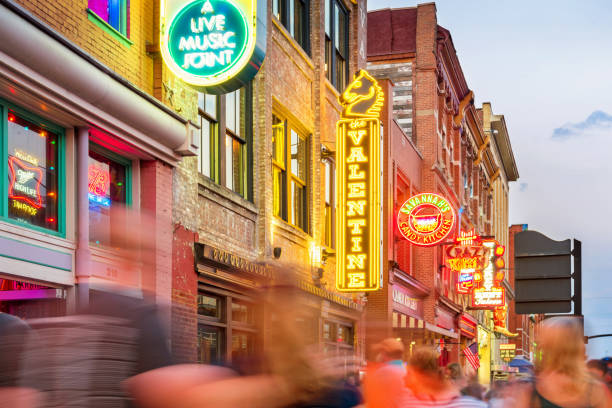 broadway pub district in downtown nashville tennessee usa - financial district stock pictures, royalty-free photos & images
