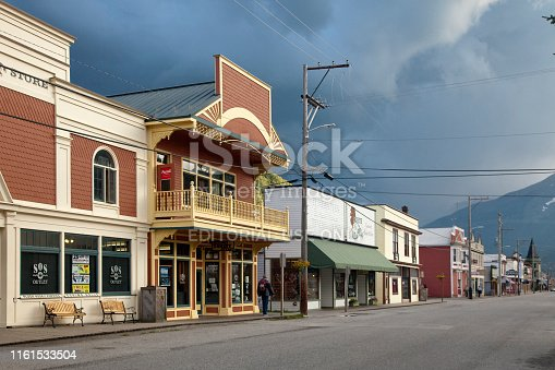 Skagway, Alaska: Panoramic view of an empty Broadway St with a stormy sky