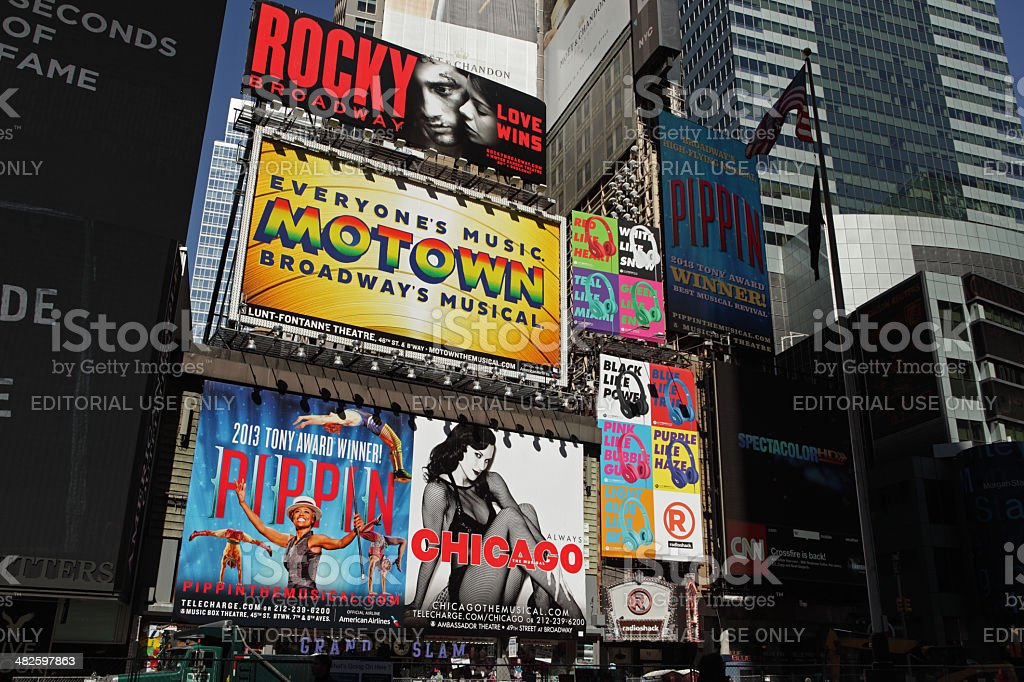 Broadway theater billboards and tourists Times Square NYC stock photo