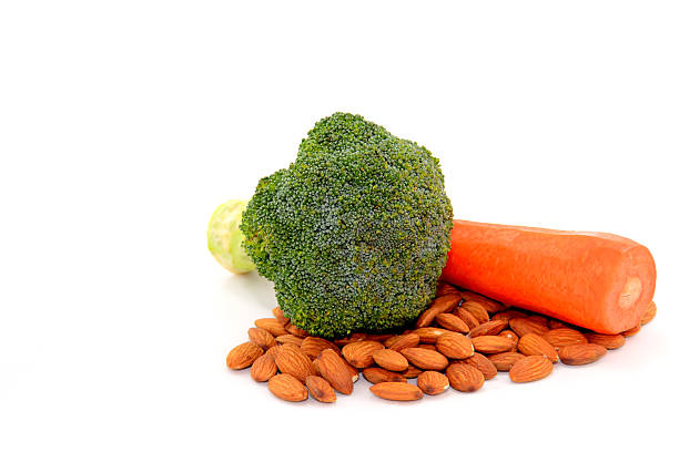 Broccoli Almonds Carrots On White stock photo