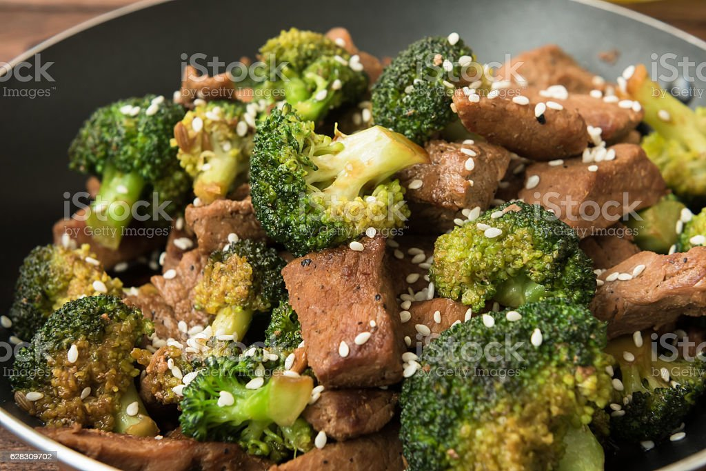 Broccoli and beef cooked on olive oil stock photo
