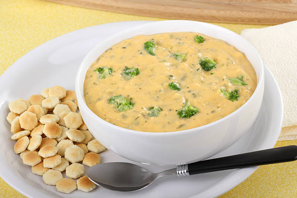 Broccoli and Cheddar Soup Creamy broccoli and cheddar cheese soup with oyster crackers cheddar cheese stock pictures, royalty-free photos & images