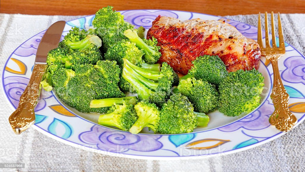 Broccoli and Sirloin Pork Chop stock photo