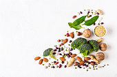 Broccoli, beans and nuts - vegan sources of vegetable protein.