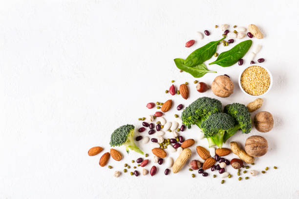 Broccoli, beans and nuts - vegan sources of vegetable protein Broccoli, beans and nuts - vegan sources of vegetable protein. nut food stock pictures, royalty-free photos & images
