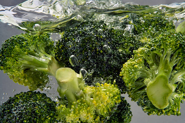 broccoli boiling in water stock photo