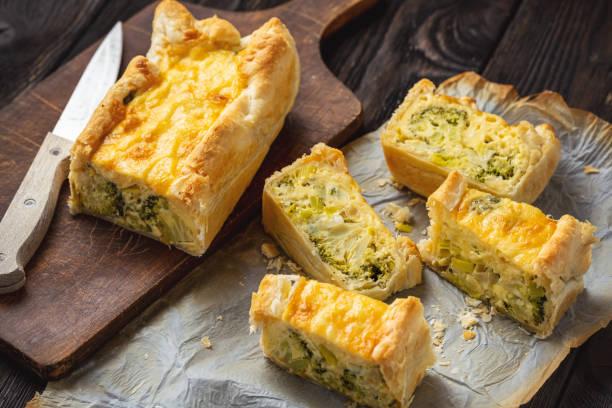 Broccoli, cheese and leek tart, vegetarian cuisine. stock photo