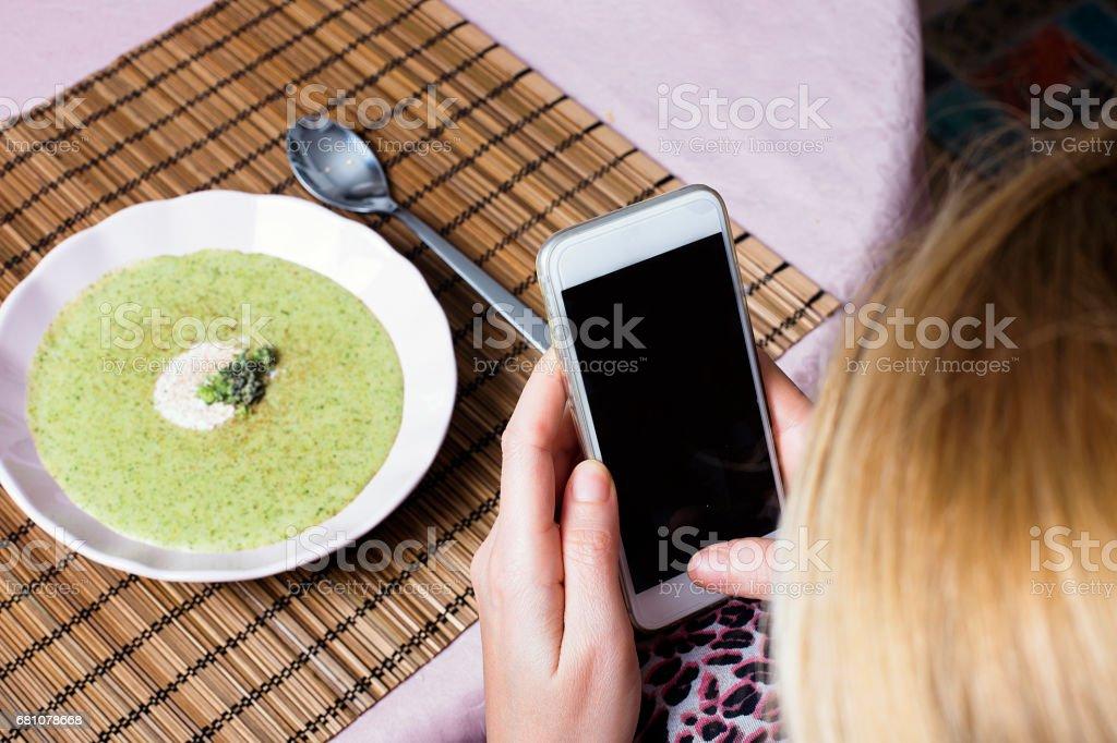 Broccoli cream soup take photo whit mobil phone royalty-free stock photo