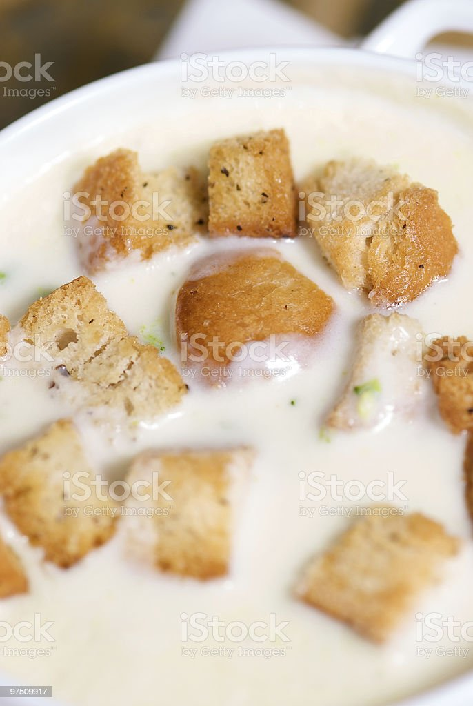 Broccoli cream soup with bread pieces close-up royalty-free stock photo