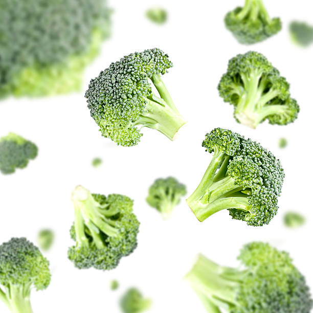 broccoli explosion - broccoli white background stock photos and pictures