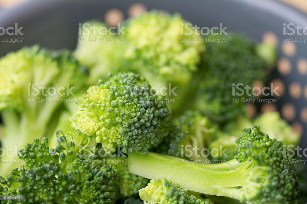 Broccoli florets in grey colander stock photo