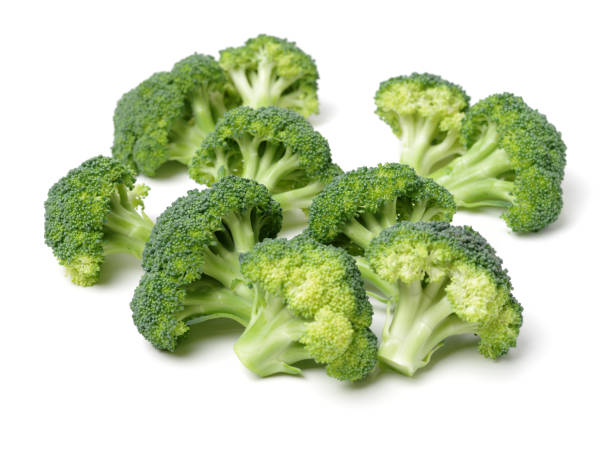 broccoli isolated on white background - broccoli white background stock photos and pictures