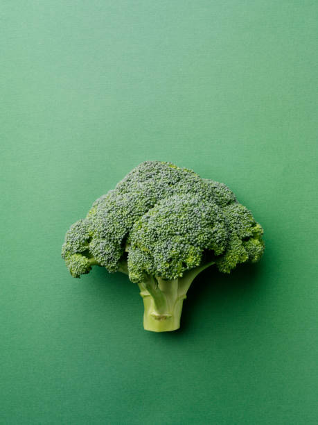Broccoli on a Green Background stock photo