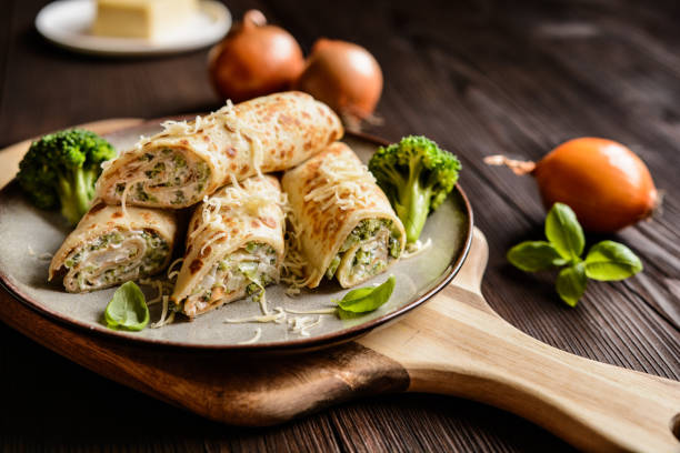 broccoli pancakes with sour cream, cheese and onion - savory food stock photos and pictures