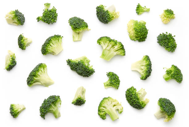 Broccoli pattern isolated on a white background. Various multiple parts of broccoli flower. Top view. stock photo