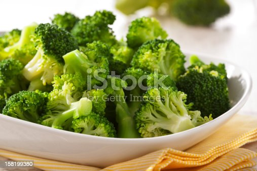 Steamed broccoli in a bowl close up