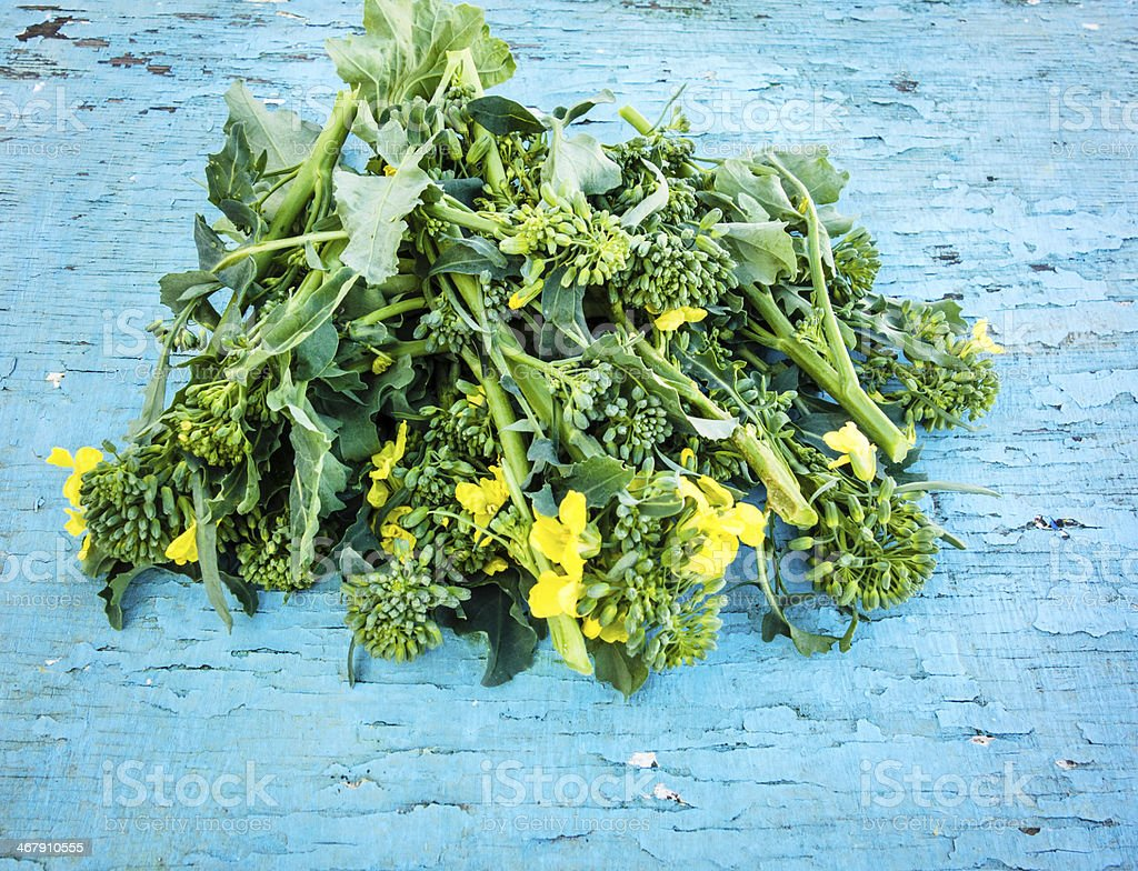 Broccoli Raab on Blue Wood stock photo
