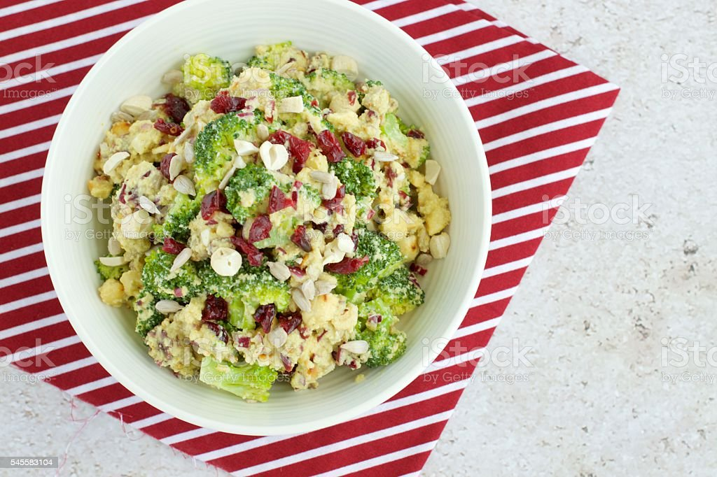 Broccoli salad with cranberry , cashew nut and sunflower seed stock photo