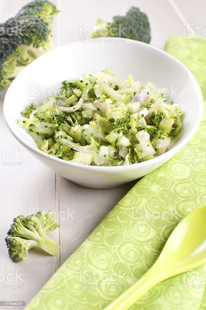 Broccoli salad with cucumber and onions royalty-free stock photo