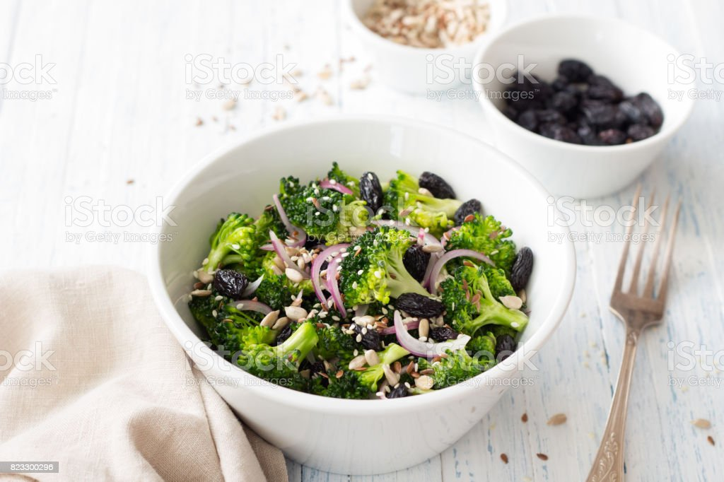 Broccoli with raisins, red onions and seeds stock photo