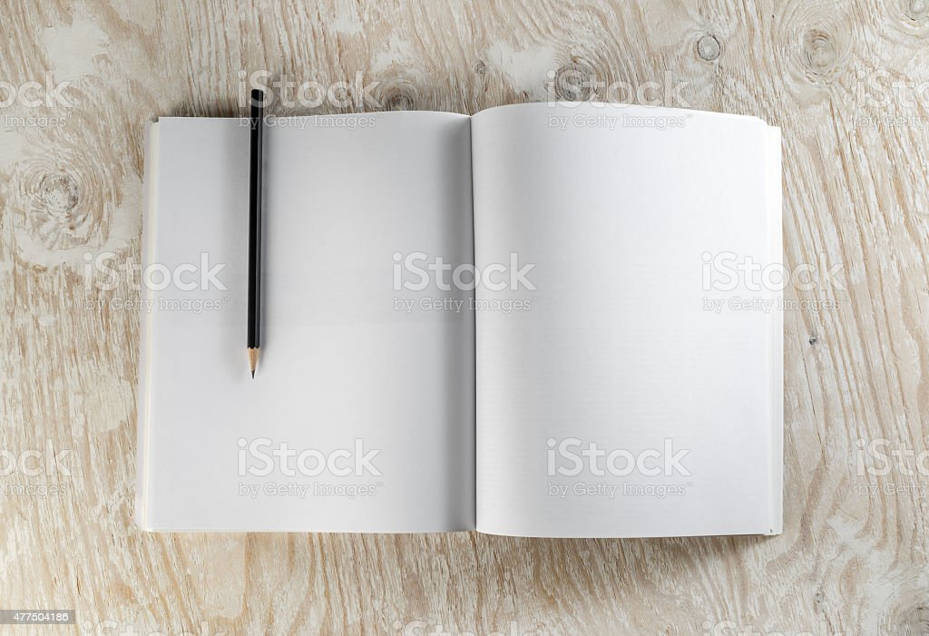 Brochure with a pencil stock photo