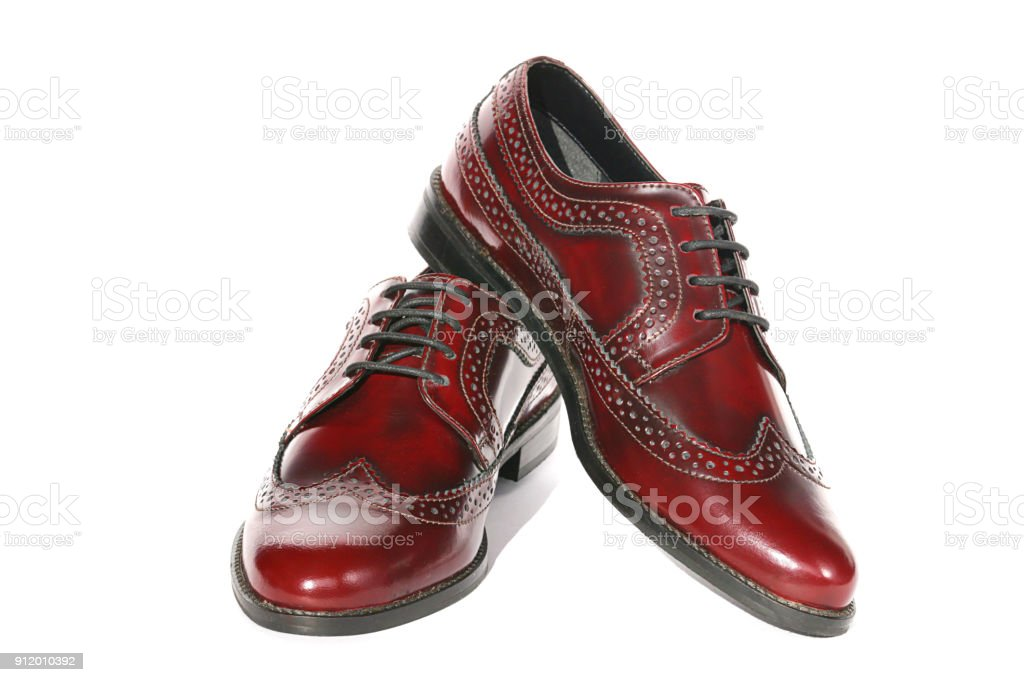 Brogues of brown genuine leather isolated on a white background. stock photo