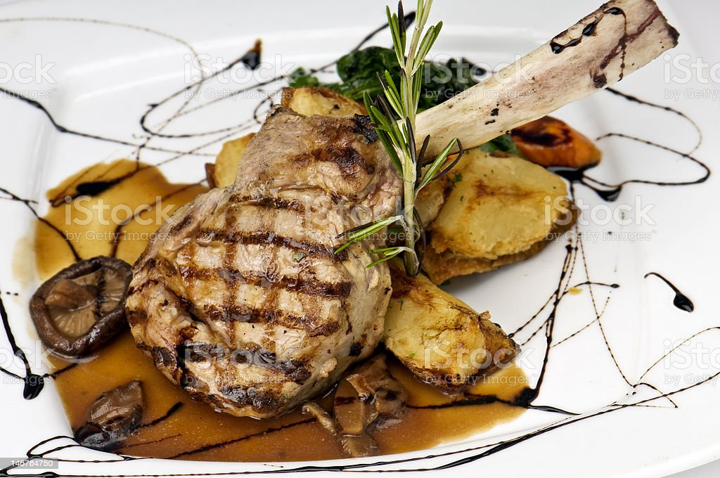 Broiled center cut veal chop stock photo