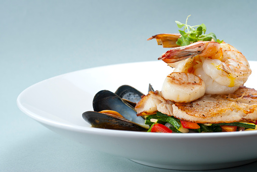 Seafood medley of shrimp, scallops, mussels and fresh fish over a bed of vegetables.