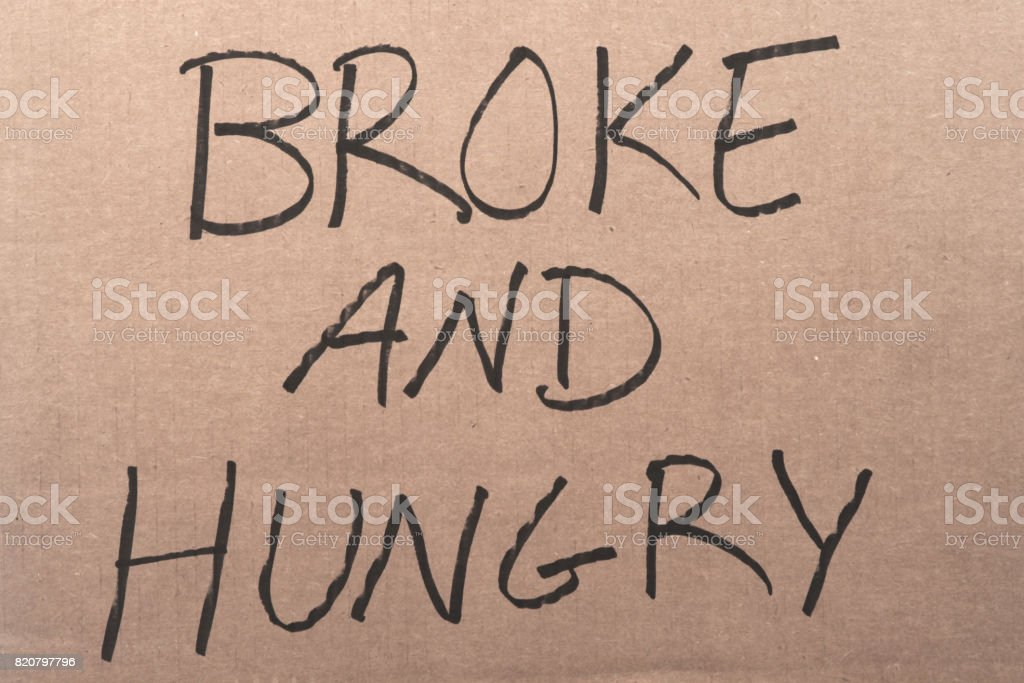Broke and hungry cardboard sign stock photo