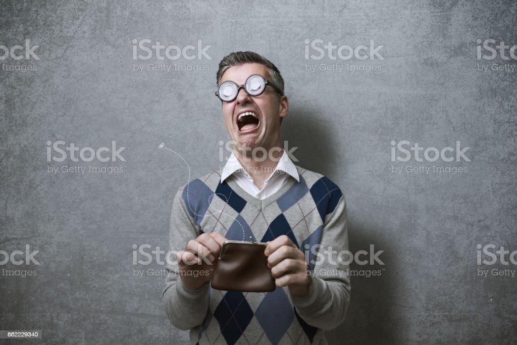 Quebrou a cara com a bolsa vazia foto de stock royalty-free