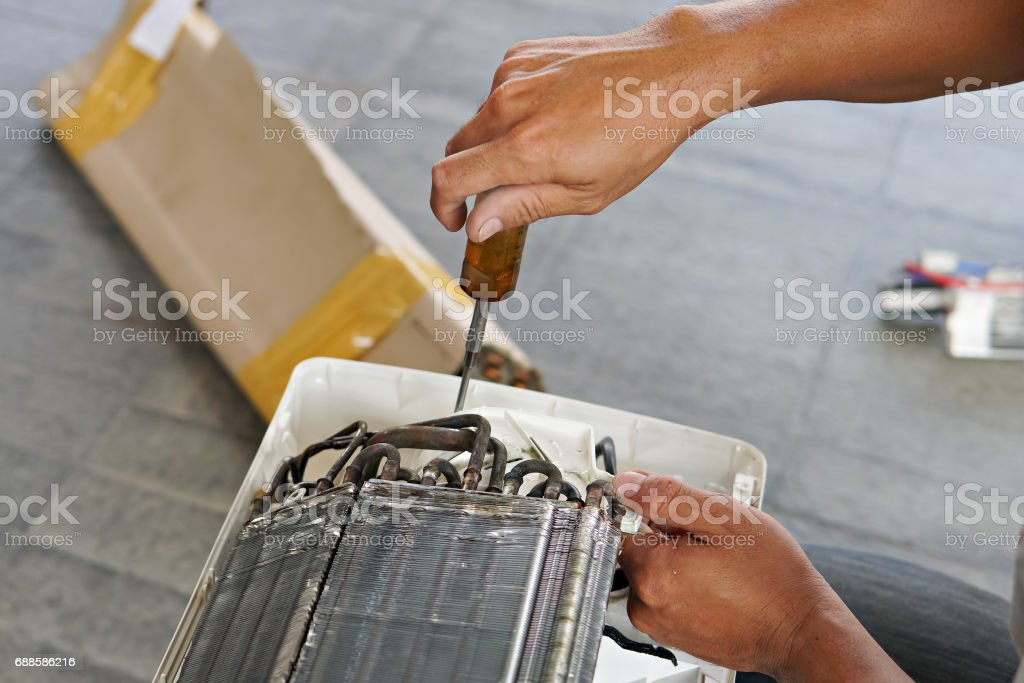 Broken AC condenser stock photo