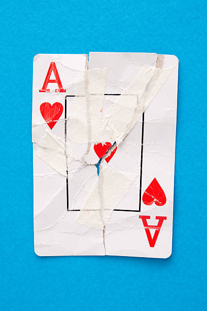 Broken ace of hearts stock photo