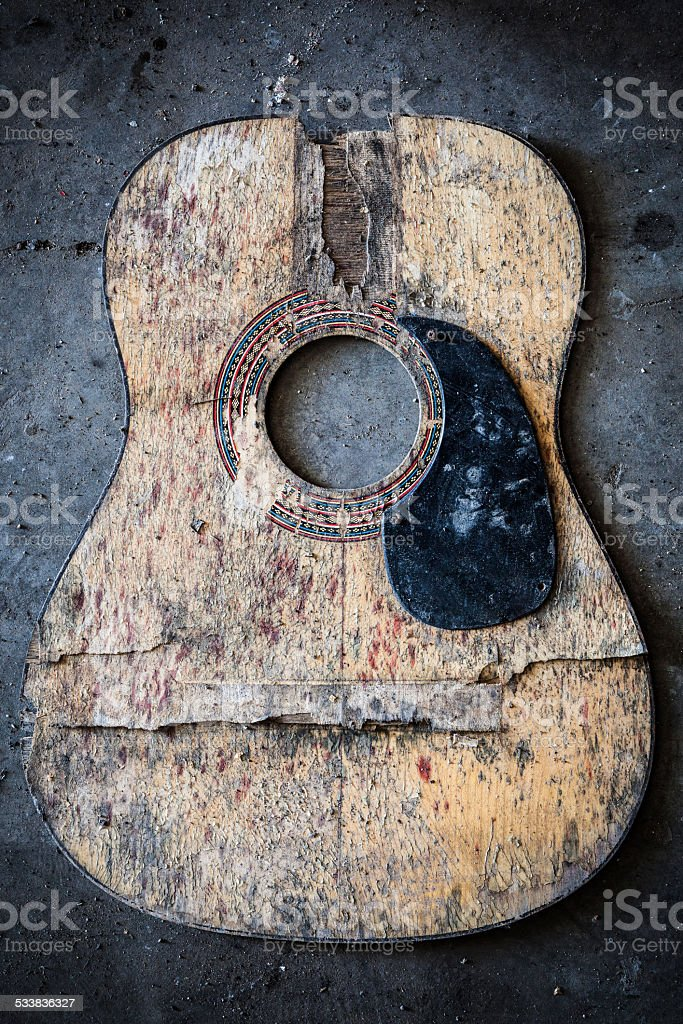 Broken acoustic guitar stock photo