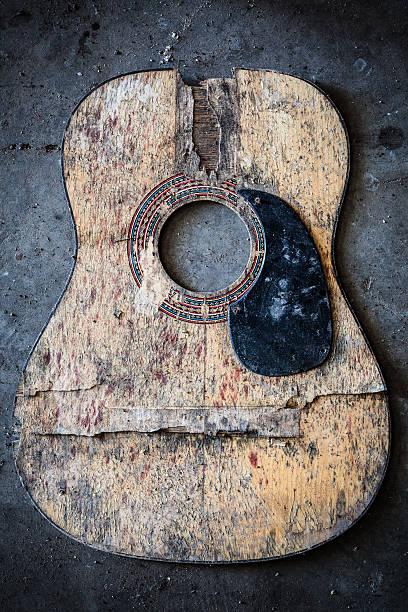broken acoustic guitar - broken guitar stock photos and pictures