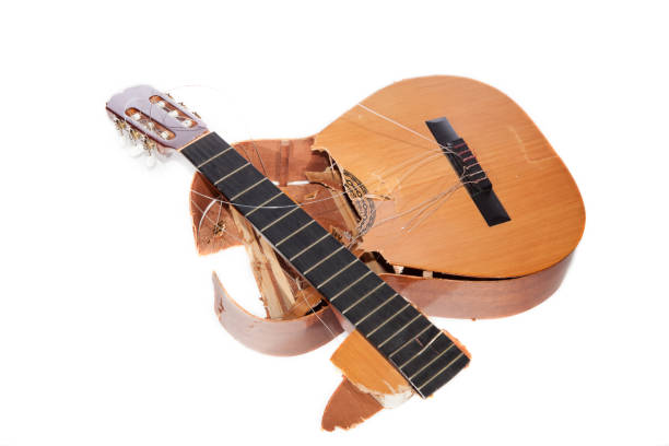 broken acoustic guitar smashed to pieces. frustrated angry musician. - broken guitar stock photos and pictures