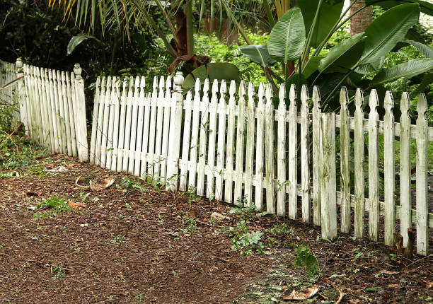 broken and neglected picket fence stock photo