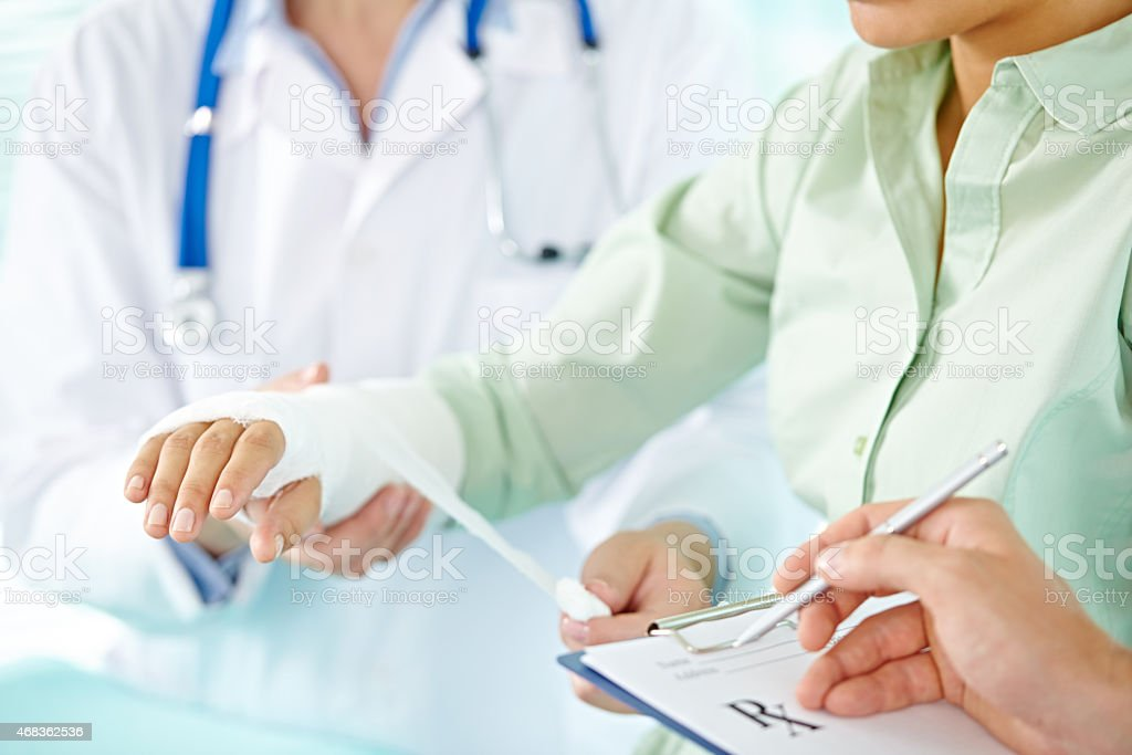 Broken arm treatment stock photo