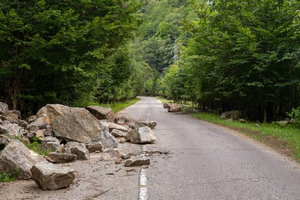 broken asphalt road - boulder rock stock pictures, royalty-free photos & images