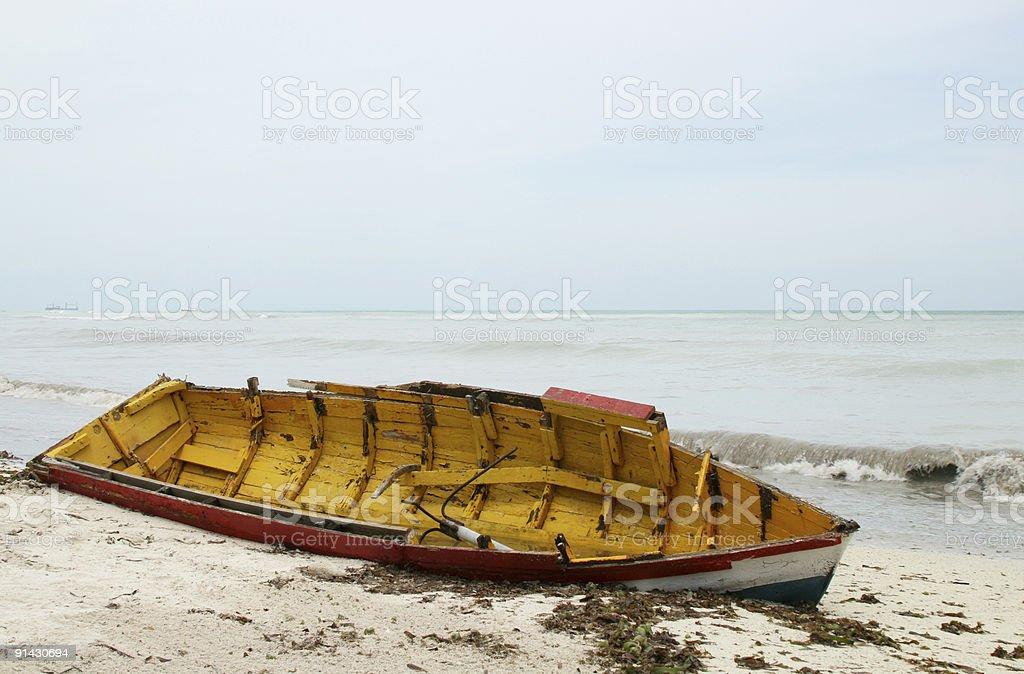 broken beached row boat royalty-free stock photo